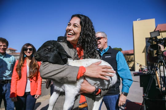 Congresswoman Xochitl Torres Small holds a baby sheep after she held a press conference on NMSU campus to announce her intention to seek to fill the vacancy on the House Agriculture Committee on Thursday, Feb. 20, 2020.
