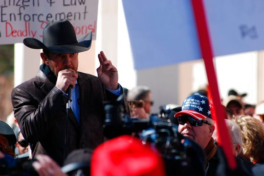 Otero County Commissioner Couy Griffin speaks Friday, Jan. 31, 2020, in Santa Fe, N.M., as hundreds of advocates for gun rights rallied at the New Mexico Statehouse against a proposed red-flag gun law that has the support of Democratic Gov. Michelle Lujan Grisham.