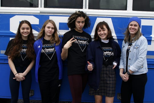 Sophia Corder, Colette Dhenin, Izabella Morgan, Isabella Corder and swim coach Kerry Smith pose on Feb. 20, 2020 before heading out to the state meet in Albuquerque.