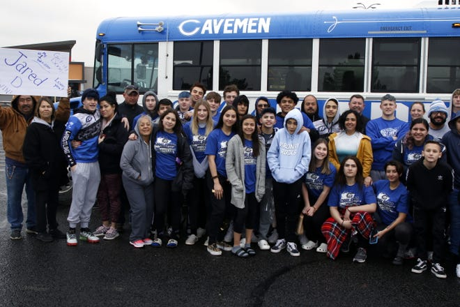 The Carlsbad wrestling and swimming teams pose with their families before heading off to the state tournaments this weekend. The swim team will be at Albuquerque Academy and the wrestling team will be at the Santa Ana Star Center in Rio Rancho.
