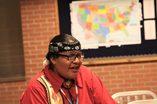 Shane Jones sings a Navajo Shoe Game song at Navajo Preparatory School's shoe game on Feb. 19, 2020, in Farmington.
