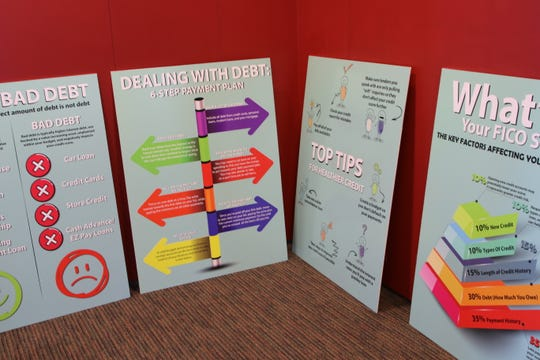 "Visual displays geared toward adults are positioned in the outer ring of the ""Thinking Money for Kids"" exhibition opening this weekend at the Farmington Public Library."