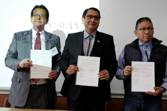 San Juan County Commission Chairman Jack Fortner, Navajo Nation President Jonathan Nez and Vice President Myron Lizer hold signed memorandums of understanding for partnering on a railroad, Thursday, Feb. 20, 2020, during a ceremony at San Juan College's School of Energy.