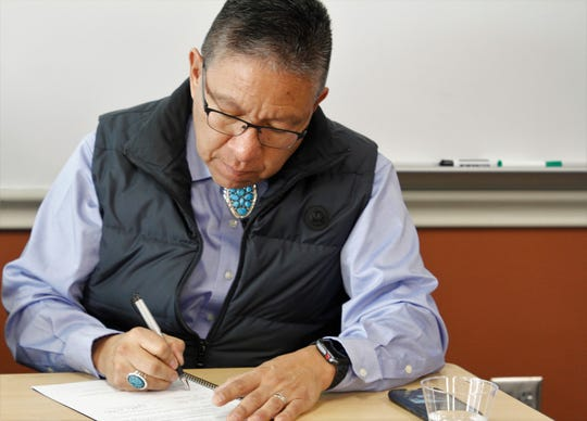 Navajo Nation Vice President Myron Lizer signs a memorandum of understanding with San Juan County, Thursday, Feb. 20, 2020, during a signing ceremony at San Juan College's School of Energy.