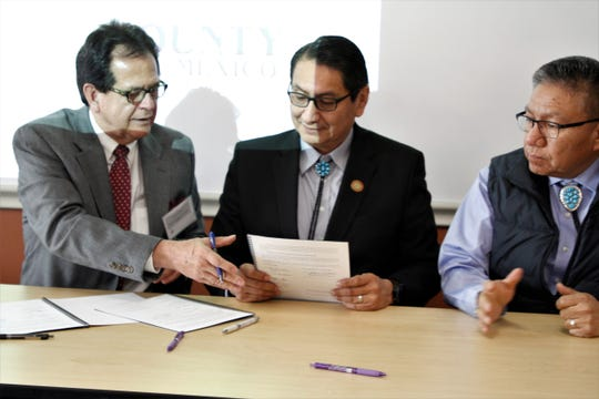 San Juan County Commission Chairman Jack Fortner, Navajo Nation President Jonathan Nez and Vice President Myron Lizer participate in a signing ceremony for a memorandum of understanding, Thursday, Feb. 20, 2020, at San Juan College's School of Energy.