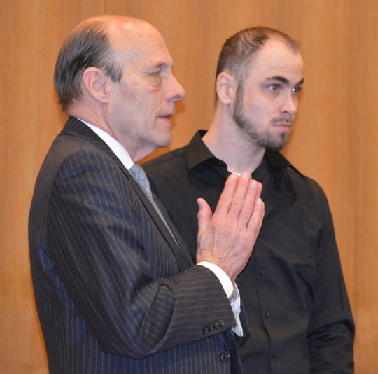 Christopher Simons was unsuccessful the morning of Thursday, Feb. 20, 2020, getting his trial adjourned. A few hours later, the judge agreed to an April date. Simons' attorney is switching from John Holmes Jr., standing here on Thursday, to Paulette Michel Loftin.