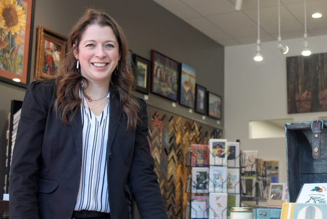Milford resident and Main Street Art owner Natalia Wohletz in the new space for the Milford business at 304 Main St. The new storefront is larger than the previous shop and can showcase more artwork.