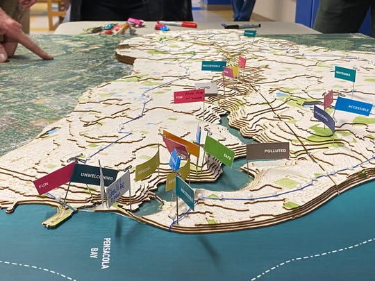 Flags on 3D map of the Carpenter Creek watershed show people's perceptions of the creek at certain location during the kickoff meeting for Carpenter Creek and Bayou Texar Watershed Management Plan at Booker T. Washington High School on Wednesday, Feb. 19, 2020.