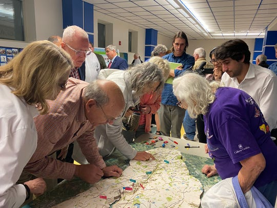 Residents look at a 3D map of the Carpenter Creek watershed at the kickoff meeting for Carpenter Creek and Bayou Texar Watershed Management Plan at Booker T. Washington High School on Wednesday, Feb. 19, 2020.