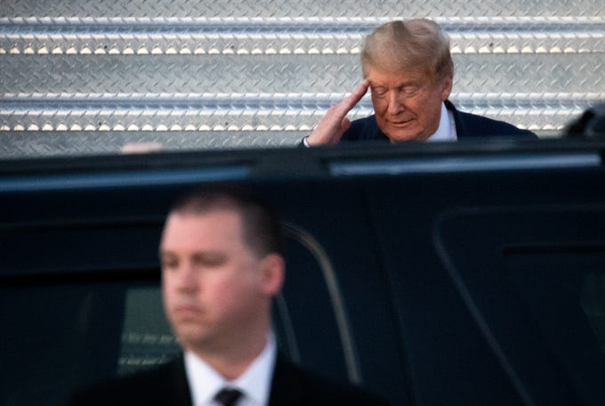 President Donald Trump walks off Air Force One, Feb. 19, 2020, after arriving at Phoenix Sky Harbor International Airport.