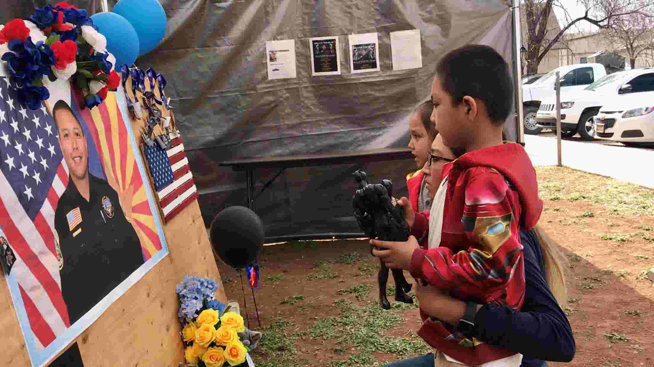 Kellywood family visits memorial of White Mountain Apache Police Officer David Kellywood