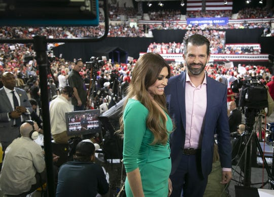 Donald Trump Jr. and his girlfriend, Kimberly Guilfoyle, during a rally before President Donald Trump spoke at the Arizona Veterans Memorial Coliseum in Phoenix on Feb.19, 2020.