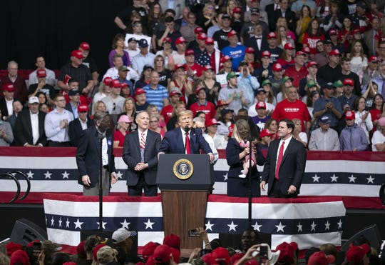 President Donald Trump speaks alongside Arizona politicians including Governor Doug Ducey (from right) U.S. Rep. Debbie Lesko, R-Ariz., and Rep. Andy Biggs, R-Ariz., during a rally  at the Arizona Veterans Memorial Coliseum in Phoenix on Feb. 19, 2020.