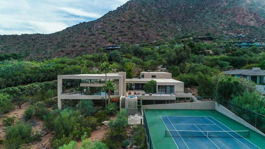 John and Erin Gogolak paid $3.2 million for a hillside lot estate in Paradise Valley.