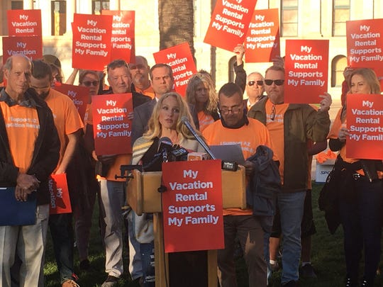 Phoenix resident Sarah Carlblom (center) speaks to a rally for owners of vacation rentals at the Arizona Capitol on Feb. 20, 2020.