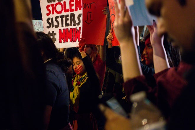 Representatives of Missing and Murdered Indigenous Women gather outside to protest at a Trump rally at the Arizona Veterans Memorial Coliseum February 19, 2020 in Phoenix. (Nicole Neri/The Republic)
