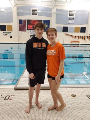 Stephen Barlett, left, and Abby O'Leary are standout divers at Northeastern High School.