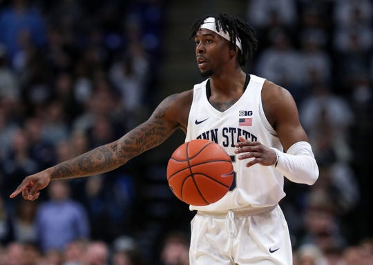 Feb 15, 2020; University Park, Pennsylvania, USA; Penn State Nittany Lions guard Jamari Wheeler (5) signals while dribbling the ball during the first half against the Northwestern Wildcats at Bryce Jordan Center. Penn State defeated Northwestern 77-61. Mandatory Credit: Matthew OHaren-USA TODAY Sports