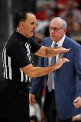 Official Roger Ayers calls a technical foul on Syracuse Orange head coach Jim Boeheim during the second half against the Louisville Cardinals at KFC Yum! Center. Louisville defeated Syracuse 90-66.