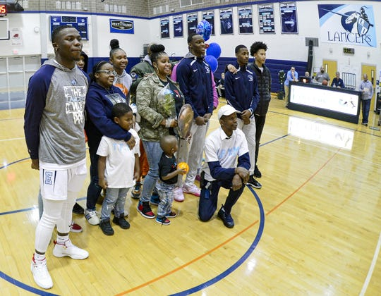 Tony Arnold, center, poses with family and friends during  Senior Night activities before a regular-season game at Eastridge High School, Wednesday, Feb. 19, 2020. Arnold has leaned on his family through tough times and is now proud to tell his story,