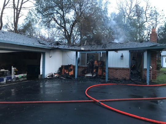 This house on Bear Mountain Road northeast of Redding was destroyed by a fire on Thursday, Feb. 20, 2020. Two residents who were inside were able to escape the flames.