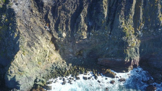 A wide-angle view of the car on the edge of a cliff in Big Sur. Feb. 20, 2020.