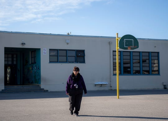 Maria Castellanoz walks through the Sherwood Elementary School playground. She's been teaching at Sherwood for  22 years. Castellanoz grew up in migrant labor camps herself. This has helped her empathize with her students experiencing homelessness.