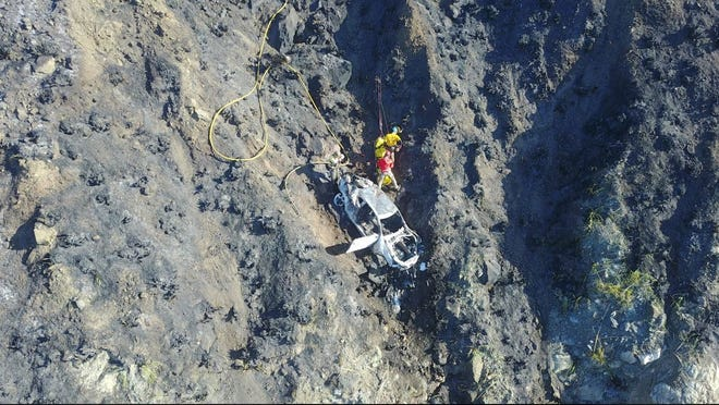 Search and rescue attend a car that plunged 300 feet down a cliff off the coast of Big Sur. Feb. 20, 2020.