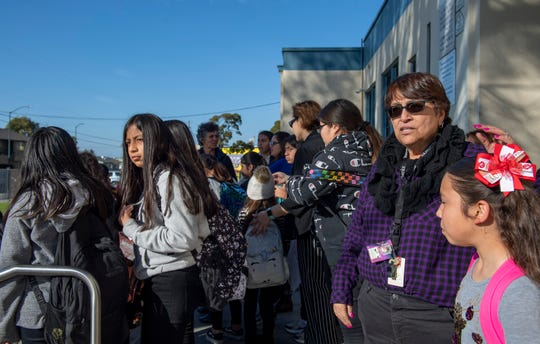 Maria Castellanoz waits outside Sherwood Elementary School as her third grade students get picked by their parents on Feb. 18, 2020. Castellanoz has taught at Sherwood for 22 years.