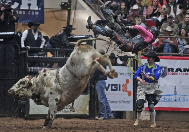 Brett Custer is thrown from a bull while competing in bull riding at the San Angelo Stock Show and Rodeo on Saturday, Feb. 15, 2020.