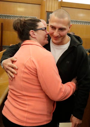 Nellie Ernisse, left, hugs Greg Althen, right, after graduating from the drug and alcohol program at Sheboygan County Circuit Court Branch 2 on Thursday, Feb. 20, 2020, in Sheboygan.