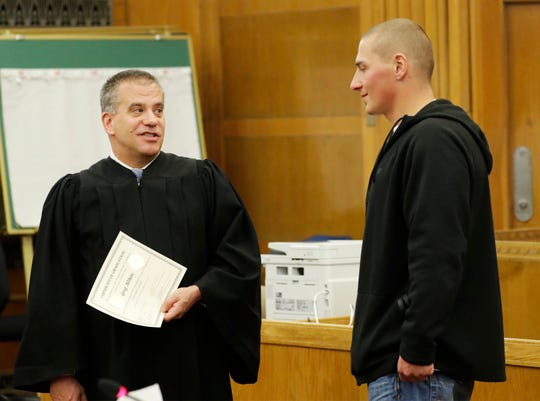 Sheboygan County Circuit Judge Kent Hoffmann, left, smiles as he talks to drug and alcohol program graduate Greg Althen at Sheboygan County Circuit Court Branch 2 on Thursday, Feb. 20, 2020, in Sheboygan.