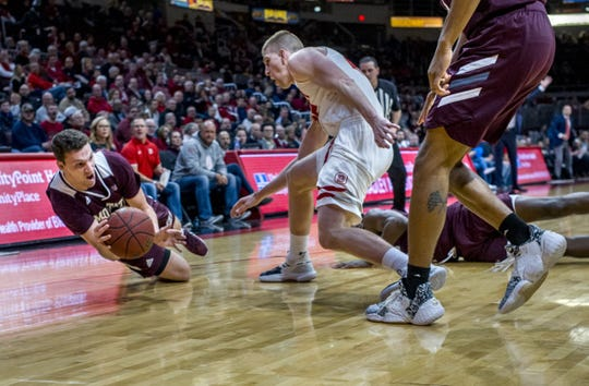 Missouri State senior Ross Owens dives for the ball on the court in a matchup against Bradley on Feb. 19, 2020, in Peoria, Illinois.