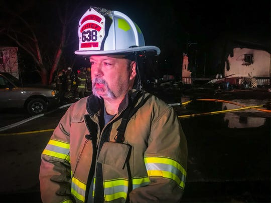 Brookline Fire Chief Ken Wilson offers an update at the scene of a mobile home fire in Republic on Wednesday.