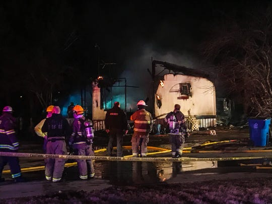 Fire crews respond to a fire at a mobile home in Republic on Wednesday