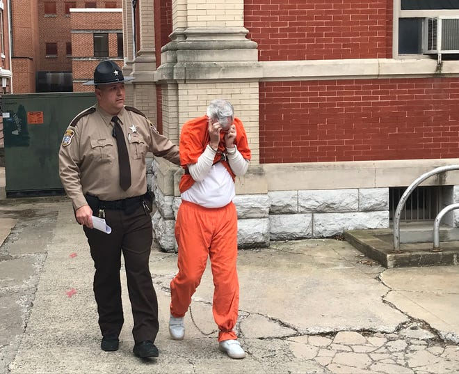 Richard L. Baber Jr., 56, of Grottoes, is escorted from the Augusta County Courthouse on Thursday after pleading guilty to contacting two girls online and soliciting sex.