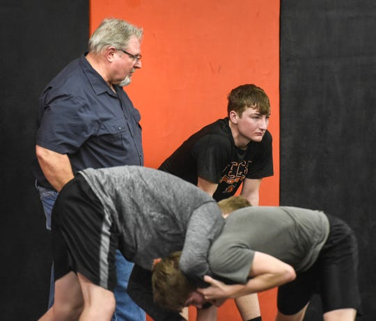 Coach Bob Boeck talks to wrestling team members during practice Wednesday, Jan. 9, 2019, at Tech High School in St. Cloud.