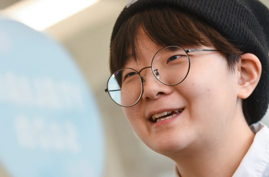 St. Cloud State University student Hyesu Cho talks about the inspirations behind her zines and graphic creations during an interview Thursday, Feb. 20, 2020, in St. Cloud.