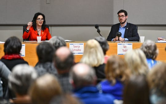 Tawnja Zahradka and Ian Todd take part in the 6th Congressional District DFL debate Wednesday, Feb. 19, 2020, at the Monticello Community Center.
