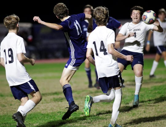 Maclay junior Michael Sweeney flicks a ball for a game-winning goal as Maclay's boys soccer team beat St. Johns Country Day 2-1 in a Region 1-2A final on Feb. 19, 2020.