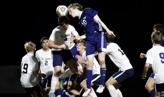 Maclay senior Beecher Lewis wins a header as Maclay's boys soccer team beat St. Johns Country Day 2-1 in a Region 1-2A final on Feb. 19, 2020.