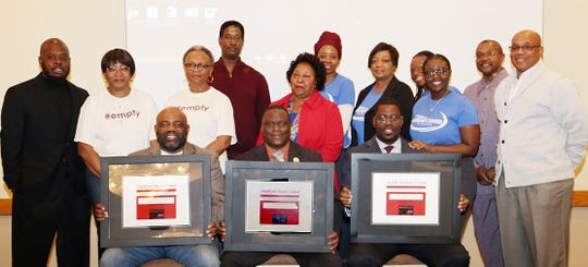 Left to right (seated), Pastor Malone Smith, Community of Hope AME Zion Church, Pastor Terry Price, Philadelphia Primitive Baptist Church, and Pastor Joseph Davis, Truth Gatherers Dream Center Church and their health leaders display plaques recognizing their churches for completion of the Health for Hearts United Program. Pastor Julius Harris, New Jerusalem Missionary Baptist Church (second row, left) and Bishop Joseph Henderson, Celebrate New Life Tabernacle (second row, right, who are members of the Health for Hearts United Pastors' Advisory Council, made the presentations on behalf of the program.