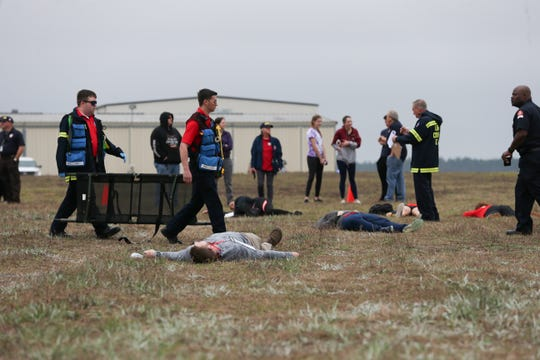 Pretend victims of a simulated airplane crash wait for emergency responders to tend to them during emergency disaster training at the Tallahassee International Airport Thursday, Feb. 20, 2020.