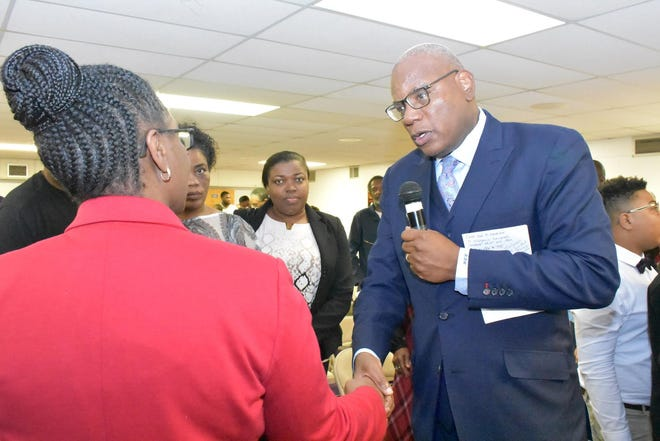 The Rev. R.B. Holmes Jr. welcomes Allison Jean, the mother of Botham Jean, to Bethel Missionary Baptist Church, continuing the church's legacy of civil rights activism and community involvement.