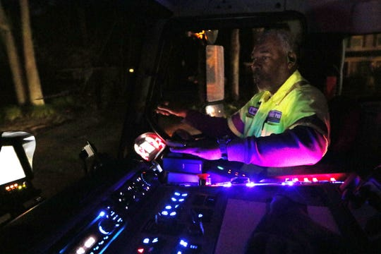 Waste Pro driver Darrell Brown Sr. drives a garbage truck on his Monday morning route.