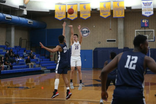 Tallahassee Community College forward Jordan Guest (23) shoots a three during a game between TCC and Pensacola State at TCC Wednesday, Feb. 19, 2020.