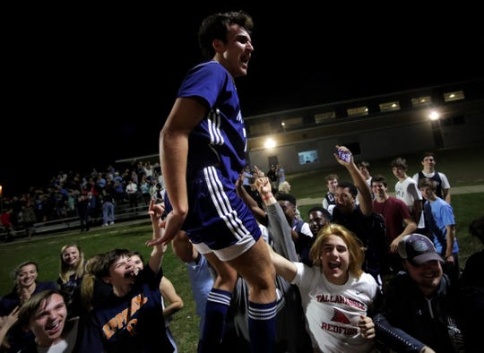 Maclay junior Mateus Bitencourt celebrates with the Marauders' fans after Maclay's boys soccer team beat St. Johns Country Day 2-1 in a Region 1-2A final on Feb. 19, 2020.
