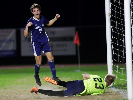 Maclay junior Mateus Bitencourt celebrates Michael Sweeney's game-winning goal as Maclay's boys soccer team beat St. Johns Country Day 2-1 in a Region 1-2A final on Feb. 19, 2020.