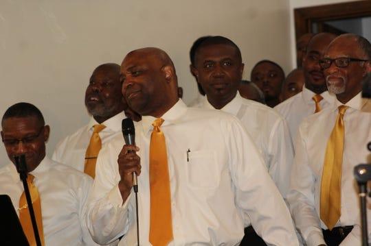 Leonard Hamilton, men's basketball coach at Florida State University, sings a solo as part of the Men's Choir at Bethel Missionary Baptist Church.