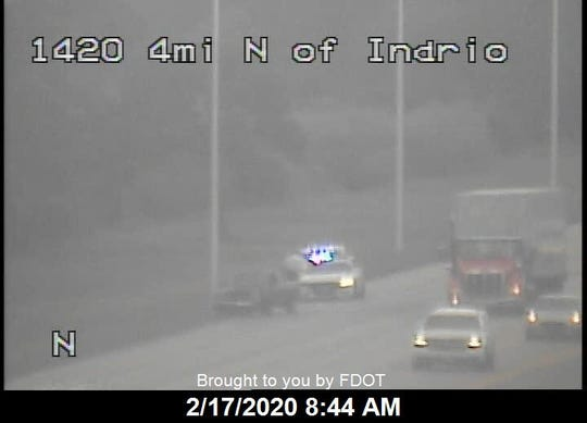 Highway traffic cameras captured images of Indian River County Sheriff's Office deputies stopped with a damaged Nissan pickup truck on Interstate 95 south of Vero Beach about one mile south of the scene of a crash involving a box truck that overturned with six people inside, officials said